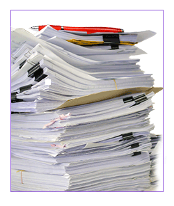 Stack of manuscripts with red pen on top